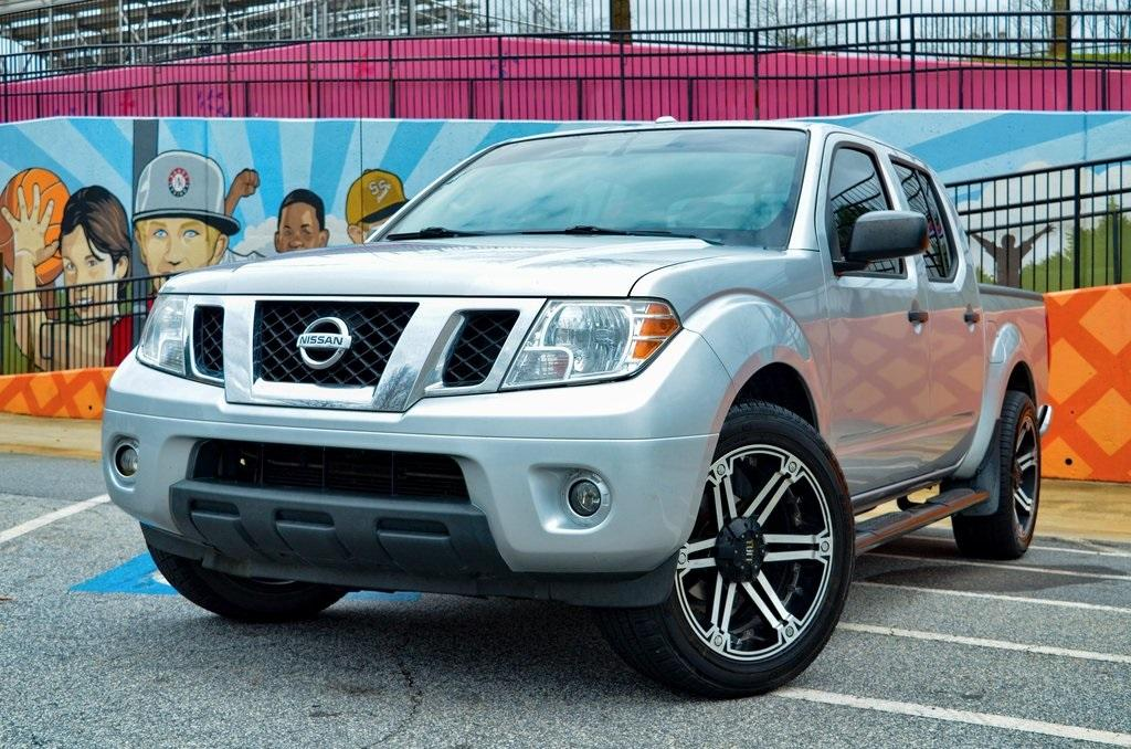 Used 2015 Nissan Frontier SV for sale $16,895 at Gravity Autos in Roswell GA 30076 1