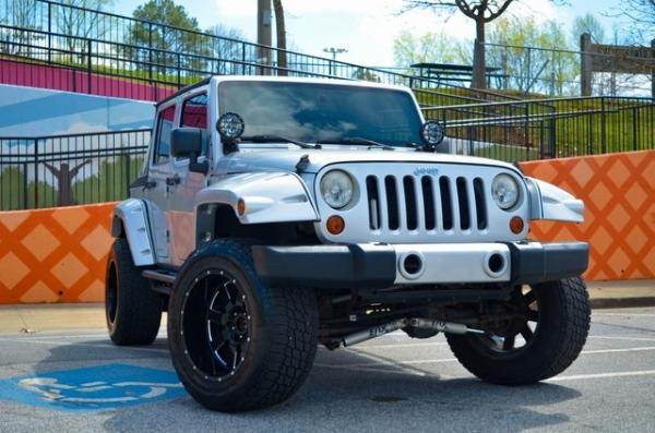 Used 2012 Jeep Wrangler Unlimited Sport for sale Sold at Gravity Autos in Roswell GA 30076 2