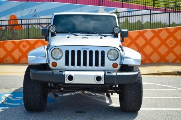 Used 2012 Jeep Wrangler Unlimited Sport for sale Sold at Gravity Autos in Roswell GA 30076 3