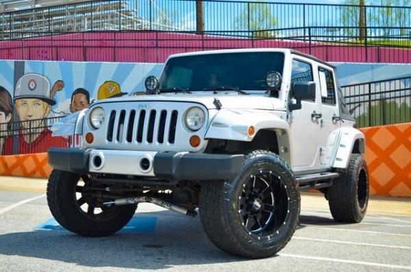 Used 2012 Jeep Wrangler Unlimited Sport for sale Sold at Gravity Autos in Roswell GA 30076 1