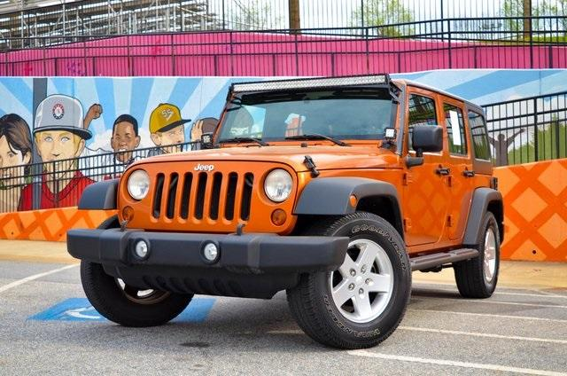 Used 2010 Jeep Wrangler Unlimited Sport for sale Sold at Gravity Autos in Roswell GA 30076 1